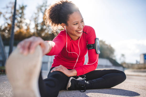 Woman stretching Woman stretching ham strings before a run touching toes stock pictures, royalty-free photos & images