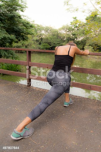 istock Woman Stretching 497807644