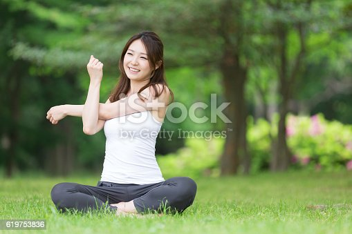 istock Woman stretching 619753836
