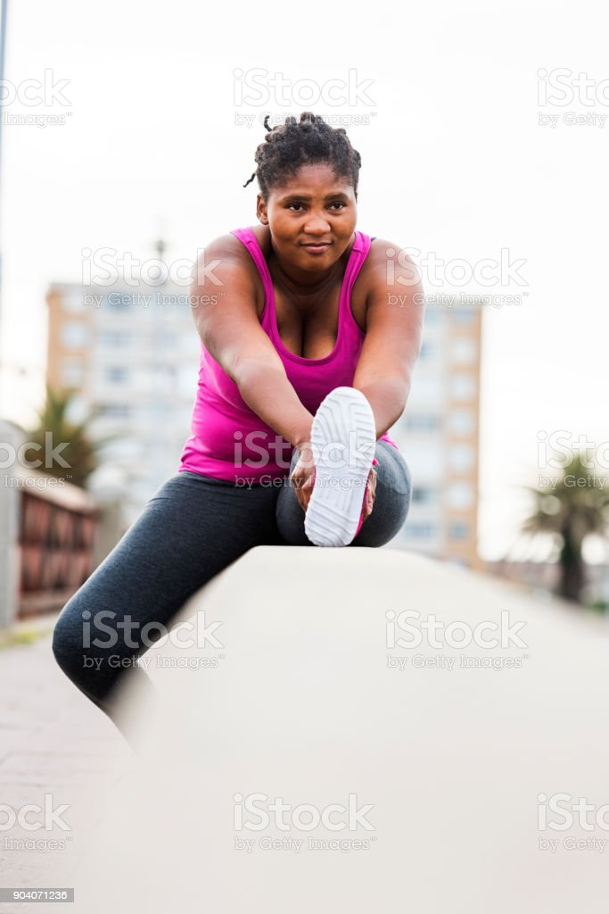 Woman stretching to warm down stock photo