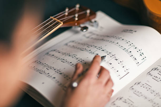 woman studying a musical score woman studying a musical score with shallow depth of field sheet music stock pictures, royalty-free photos & images