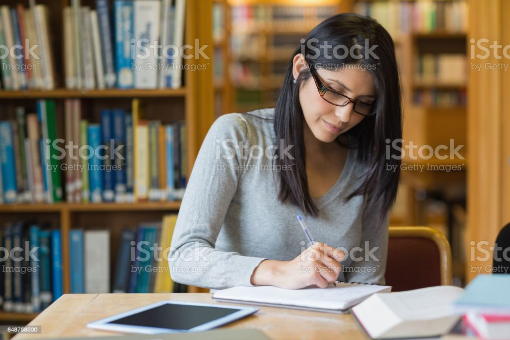 Woman studying in the library stock photo