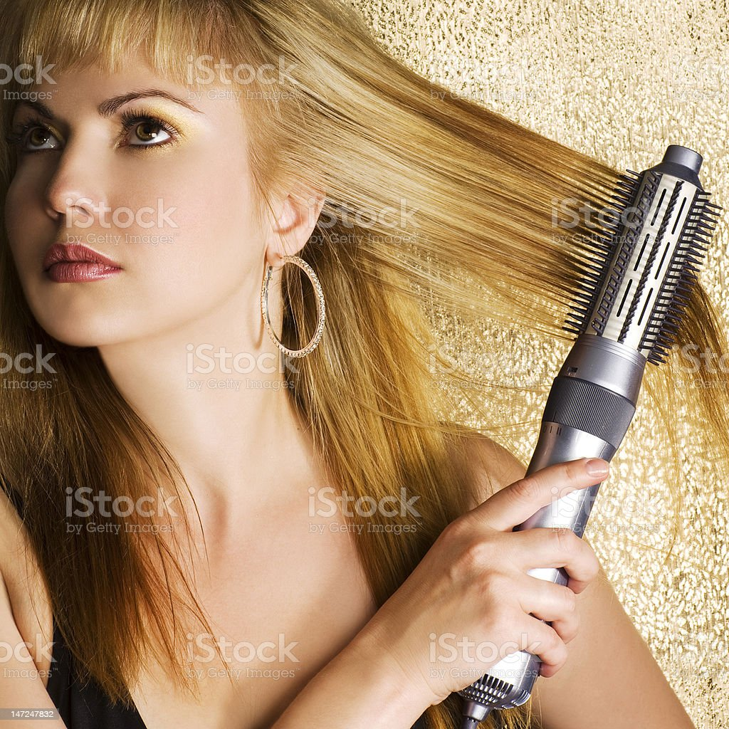 Woman styling her hair royalty-free stock photo