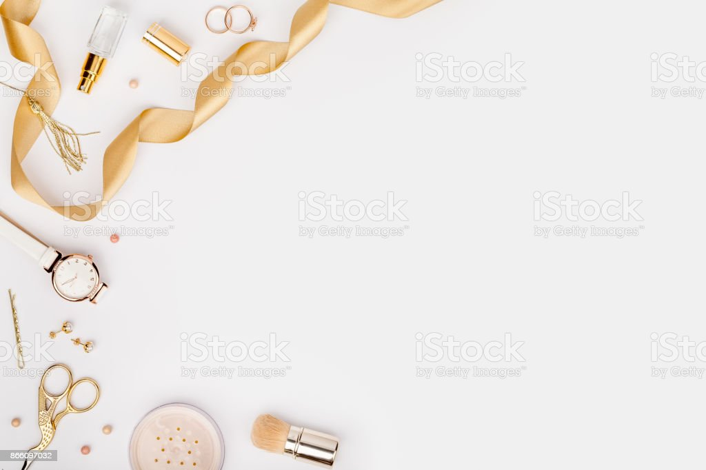 woman stylish fashion accessories in gold color on white background with copy space for text. beauty, fashion, jewelry and shopping concept. trendy flat lay composition, top view