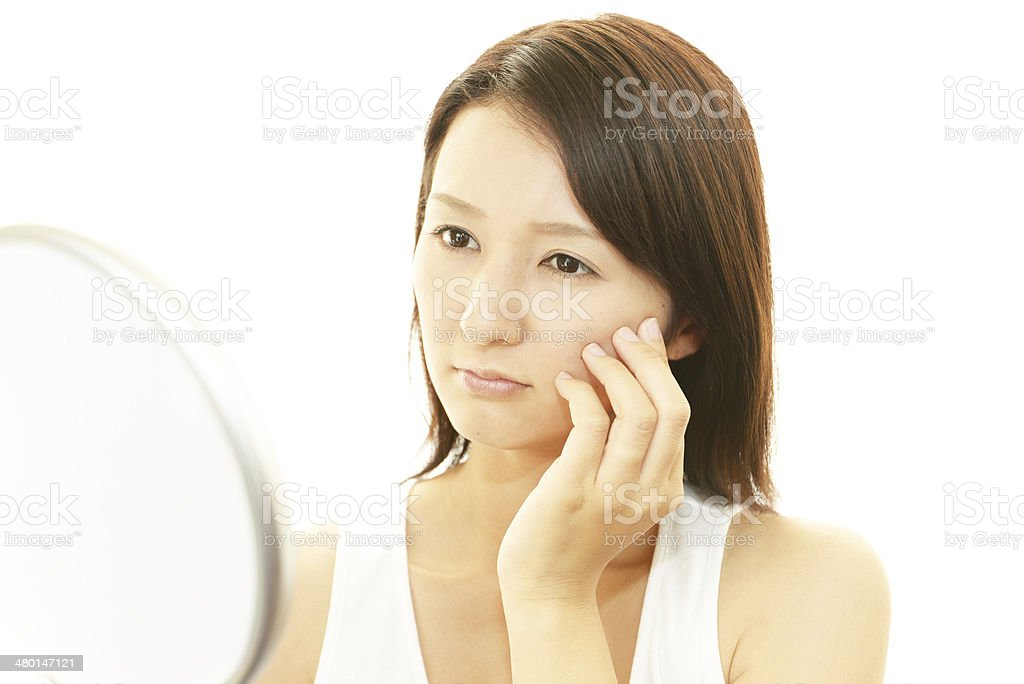 Woman suffer from wrinkles stock photo