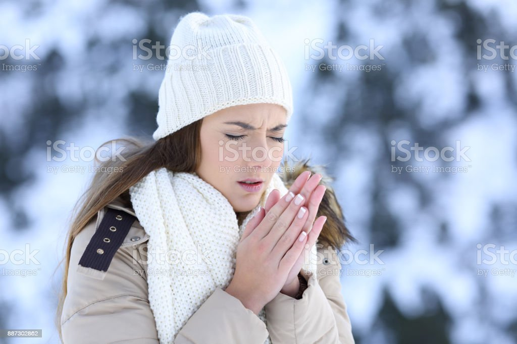 Woman suffering a cold winter outdoors stock photo
