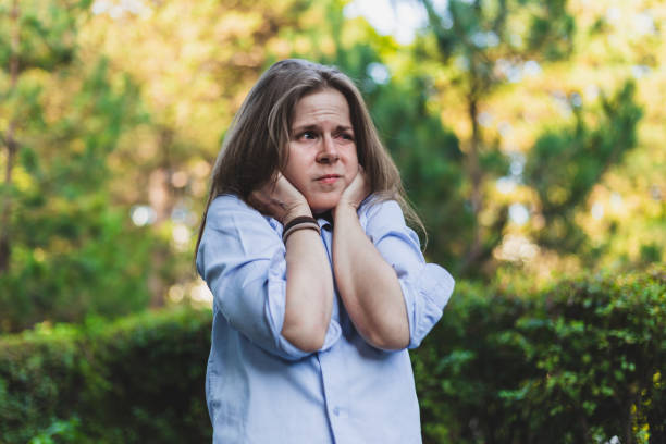 Woman suffering a panic attack stock photo