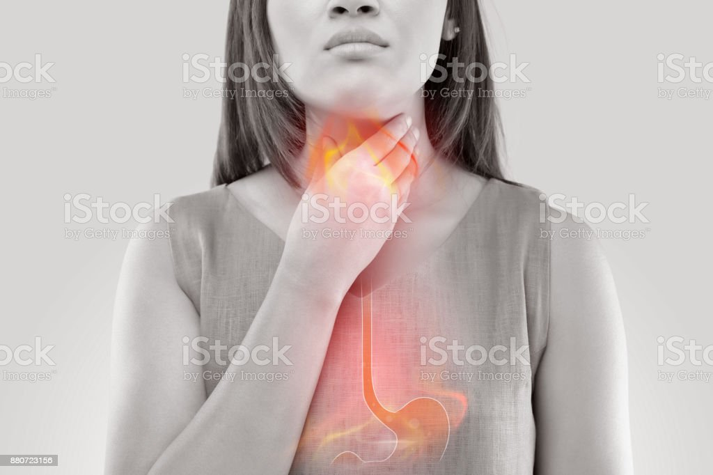 Woman Suffering From Acid Reflux Or Heartburn-Isolated On White Background stock photo