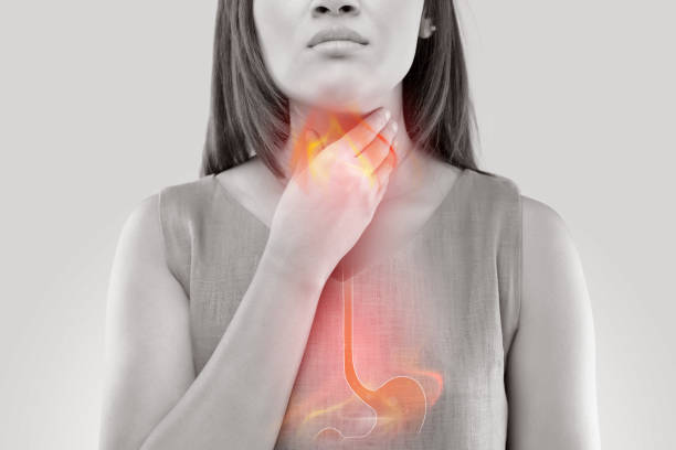 Woman Suffering From Acid Reflux Or Heartburn-Isolated On White Background Woman Suffering From Acid Reflux Or Heartburn-Isolated On White Background heartburn throat pain stock pictures, royalty-free photos & images