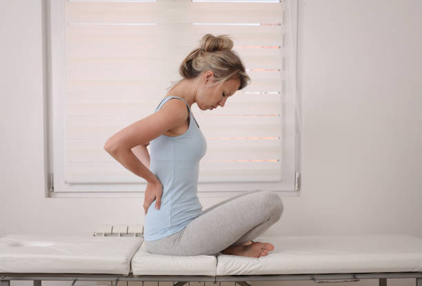 woman suffering from back and neck pain. muscle spasm, .chiropractic concept. sport exercising injury - sports medicine stock pictures, royalty-free photos & images
