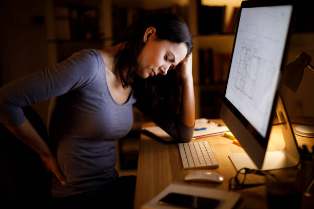Woman suffering from backache Woman suffering from backache bad posture stock pictures, royalty-free photos & images