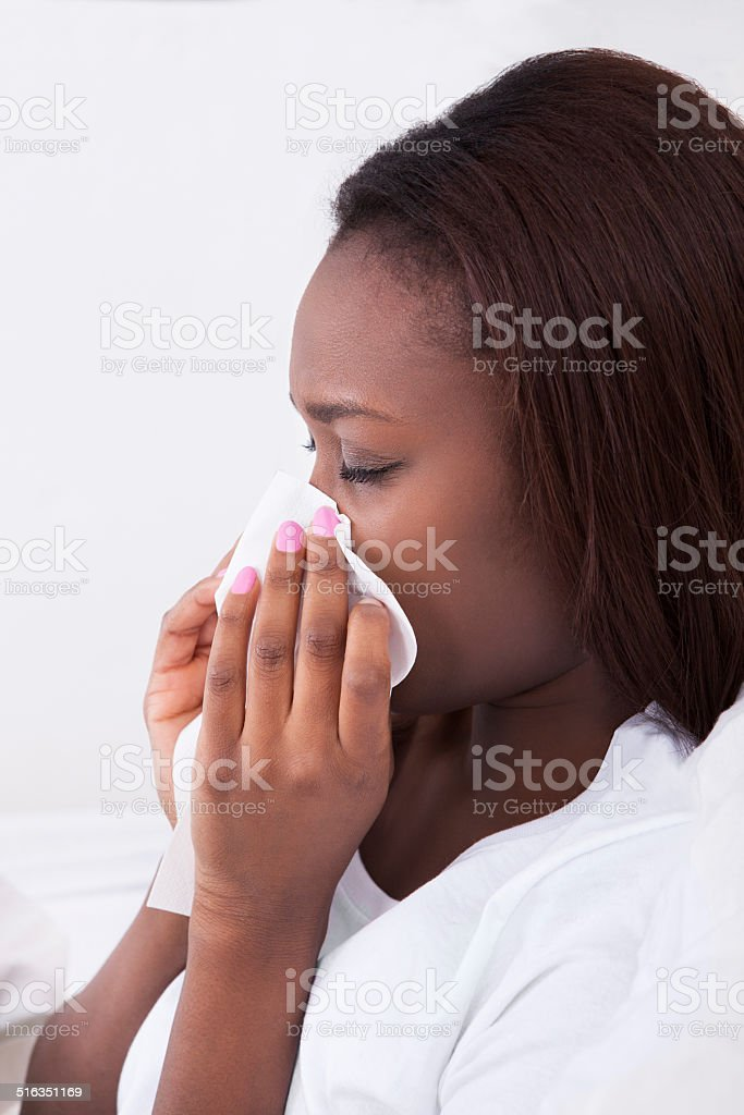 Woman Suffering From Cold At Home stock photo