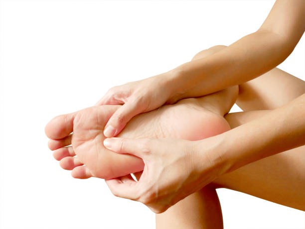 Woman suffering from foot pain Woman suffering from foot pain isolated on white background sole of foot stock pictures, royalty-free photos & images