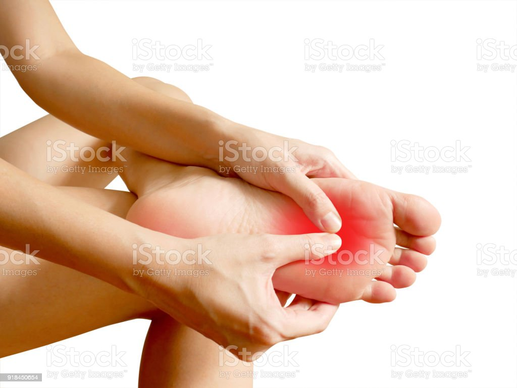 Woman suffering from foot pain stock photo