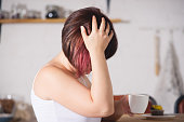 istock Woman suffering from headache at home 1027768964