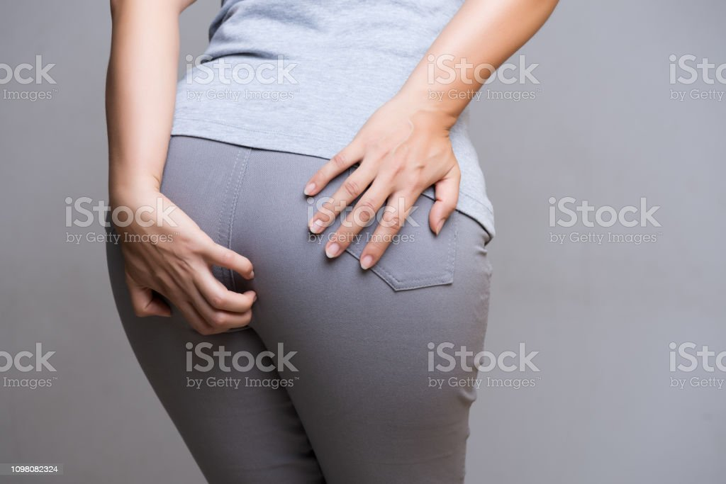 Woman suffering from hemorrhoids and hand holding her bottom because having Abdominal pain. Health care concept. stock photo