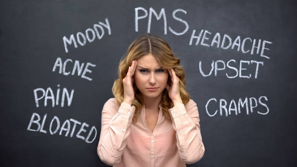 Woman suffering headache due to imaginary problems in pms, hormone imbalance stock photo