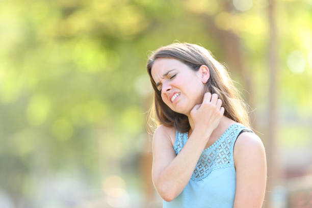 Woman suffering itching scratching neck Woman suffering itching scratching neck stinging stock pictures, royalty-free photos & images