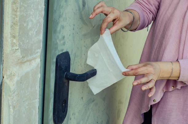 Woman suffering mysophobia prepares to open the door stock photo