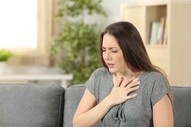 Woman suffering respiration problems stock photo