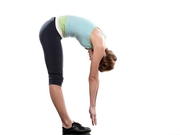 woman sun salutation yoga surya namaskar pose workout  touching toes stock pictures, royalty-free photos & images