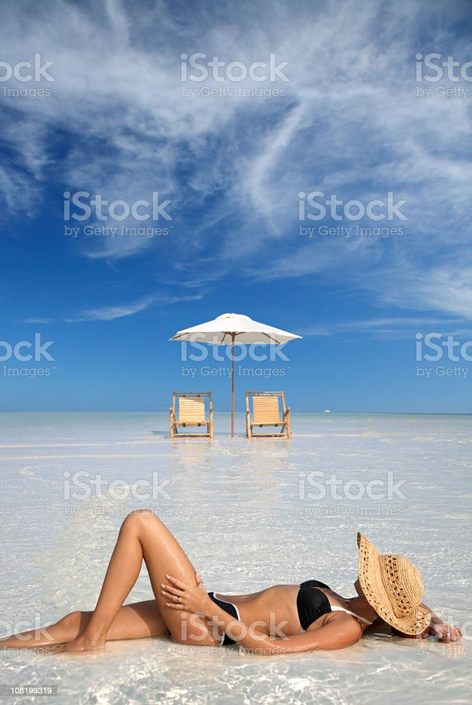 woman sunbathing at a beautiful tropical beach royalty-free stock photo