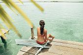 Woman sunbathing in bacalar