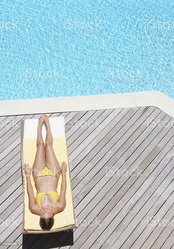 Woman sunbathing on deck outdoors royalty-free stock photo