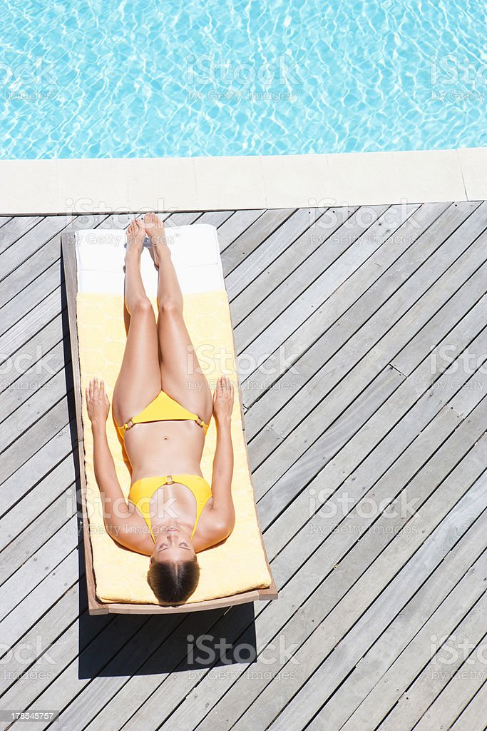 Woman sunbathing on folding chair  stock photo