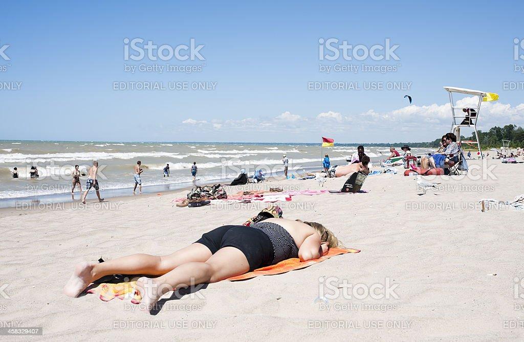Woman Sunbathing on Summer Beach stock photo