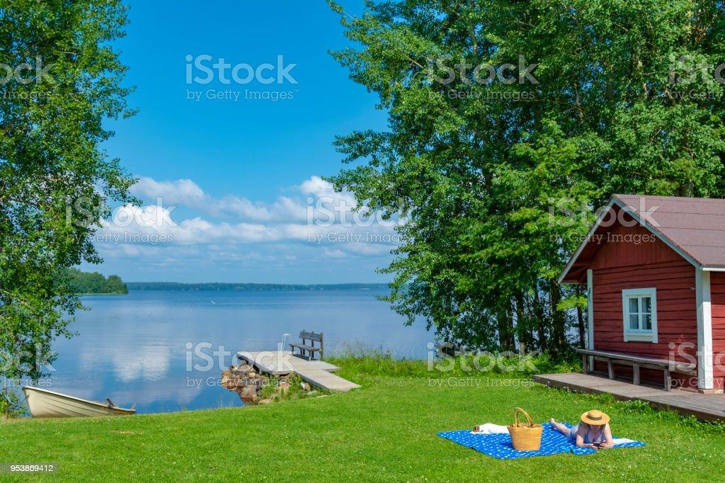 Woman sunbathing stock photo