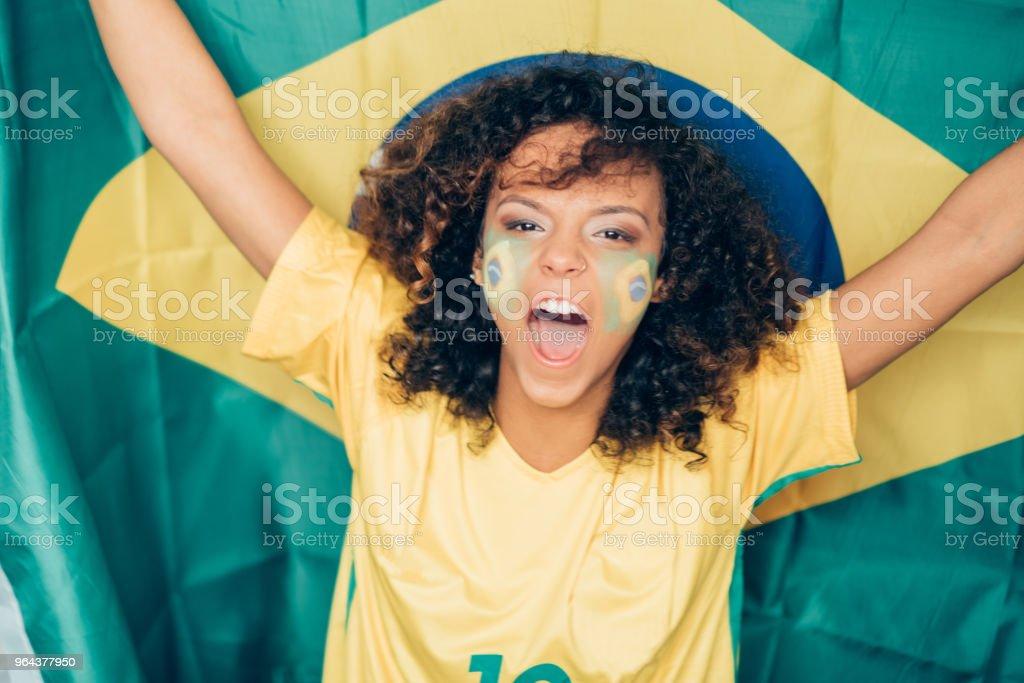 Mulher apoiando o Brasil no Campeonato Mundial de futebol - Foto de stock de Adulto royalty-free