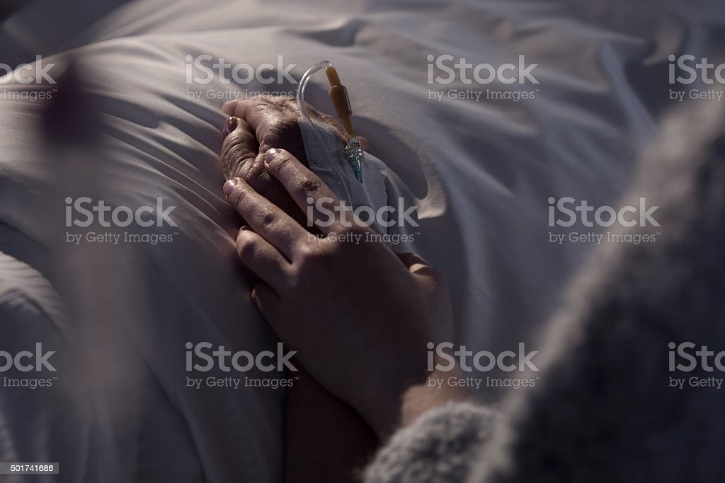 Woman supporting mother with cancer stock photo
