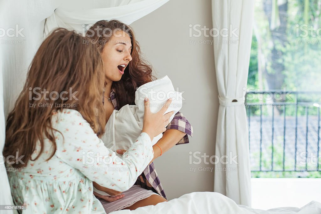 Woman supports her sister after a childbirth stock photo
