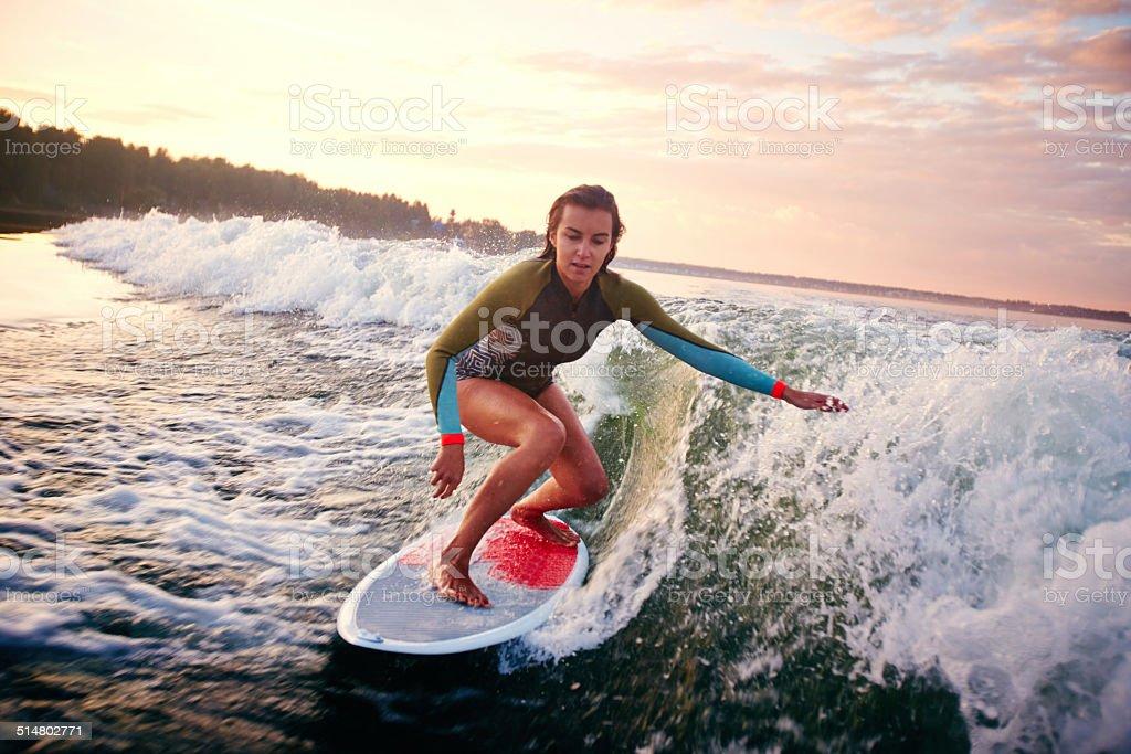 Woman surfboarding stock photo