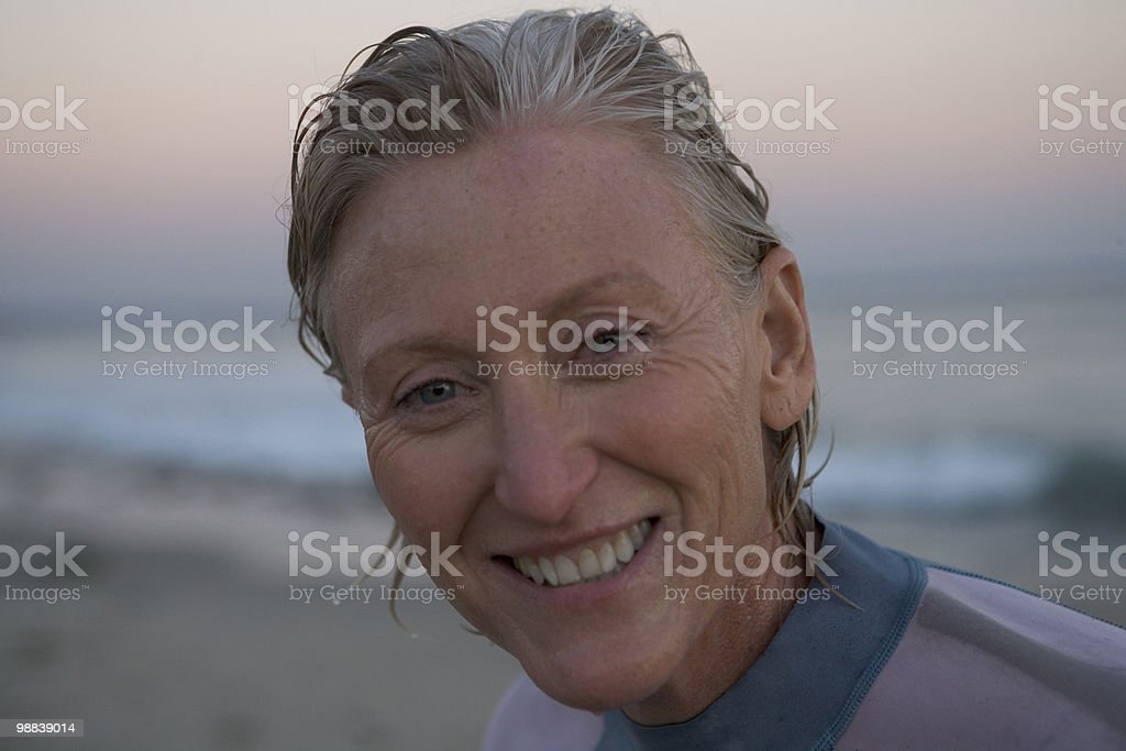 Woman surfer at sunset royalty-free 스톡 사진