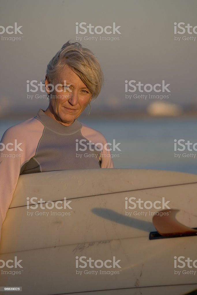 Woman surfer at sunset royalty-free stock photo