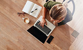 istock Woman surfing internet at coffee shop 618547538