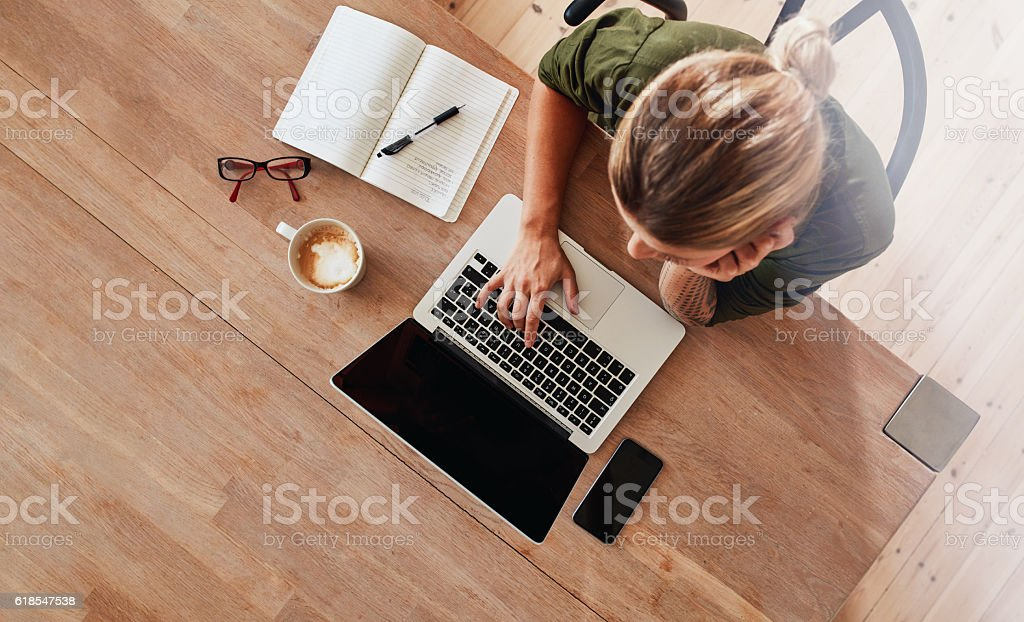 Woman surfing internet at coffee shop stock photo