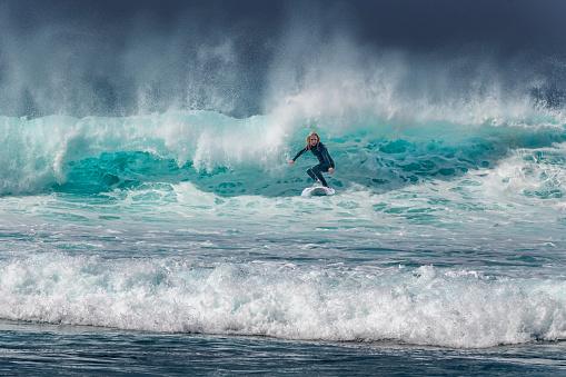 Woman Surfing on Waves in Tenerife, Playa de las Americas, Spain, Europe/ Africa, Spain,Nikon D850