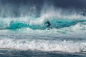 istock Woman Surfing on Waves in Tenerife, Playa de las Americas, Spain 1276914660