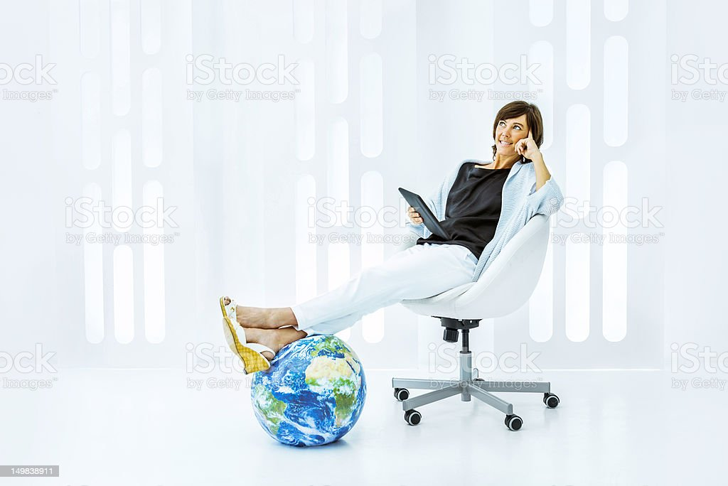 Woman surfing the net with a digital tablet royalty-free stock photo