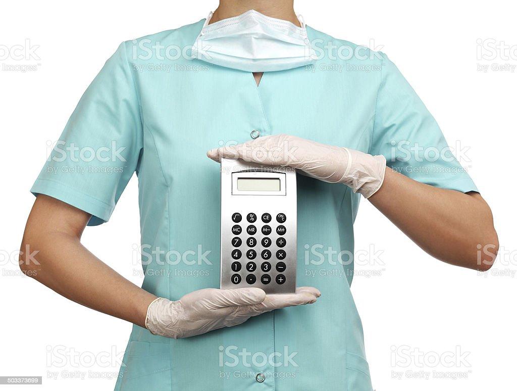 woman surgeon holding a calculator stock photo