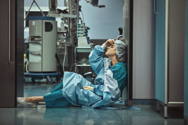 Woman surgeon looking sadness fatigue after surgery copyspace stress depression guilt unhappy problem worker medicine healthcare emotions stock photo