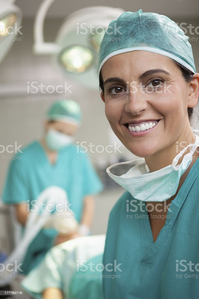 Woman surgeon smiling, getting ready for a surgery stock photo