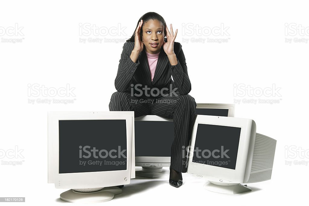Woman surrounded by computer royalty-free stock photo