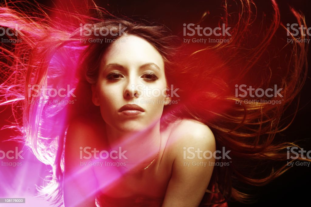 Woman Surrounded by Red Light royalty-free stock photo