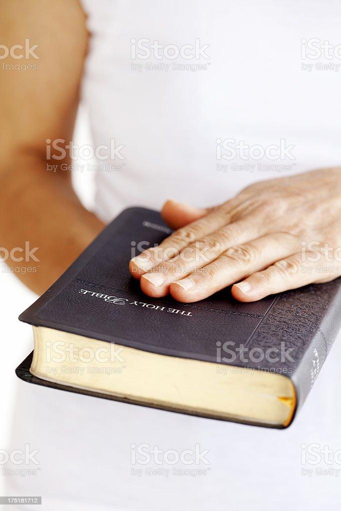 woman swearing on a bible stock photo