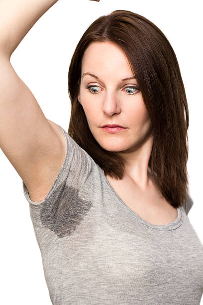 Woman sweating very badly under armpit Woman sweating very badly under armpit wet clothing women t shirt stock pictures, royalty-free photos & images