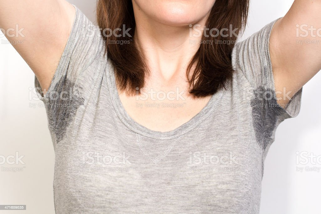 Woman sweating very badly under armpit stock photo